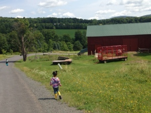Julia enjoying the fresh air fun of a working farm
