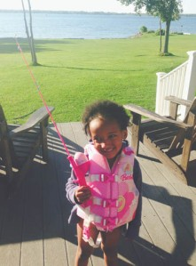 Ready for fishing with her Barbie pole and life vest, courtesy of Uncle Dan